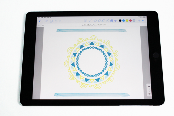 ipad showing the digital planner cover page with a mandala