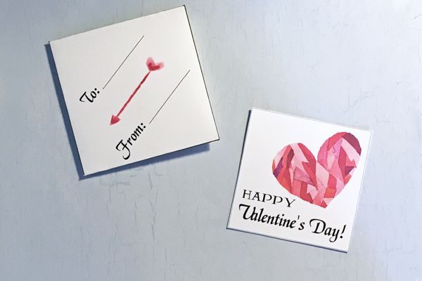 "square white card with ""happy valentine's day"" and a pink watercolor heart"