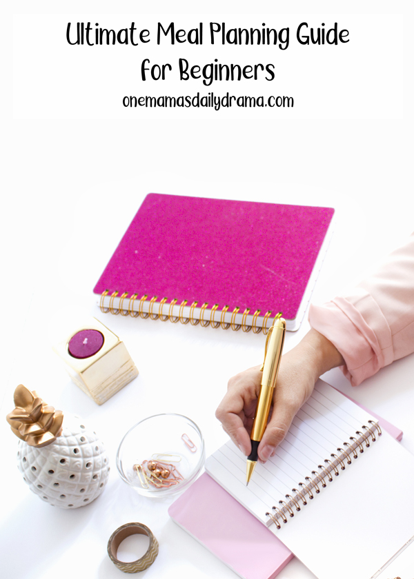 """""""ultimate meal planning guide for beginners"""" text over an image of a hand writing in a pink spiral notebook on a white desk"""