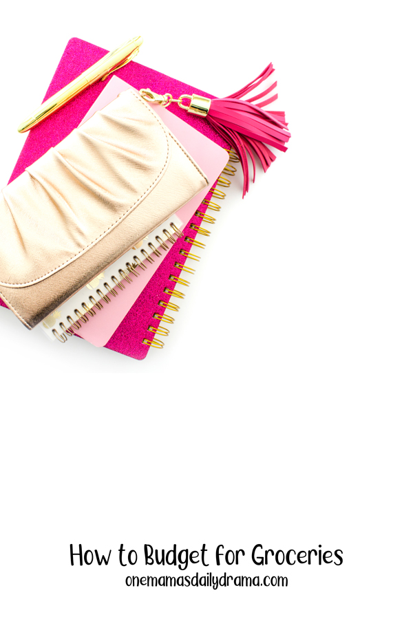 wallet on a stack of pink spirals